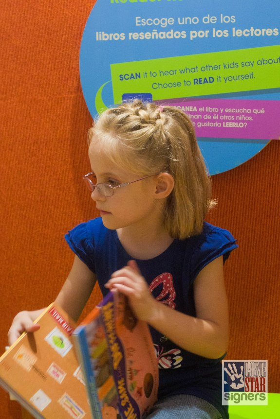 Read a book in the Imagine It area of The DoSeum, the San Antonio museum for kids.